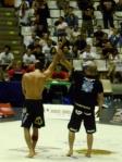 Hurt Xande Ribeiro raises emotional Estima's arm